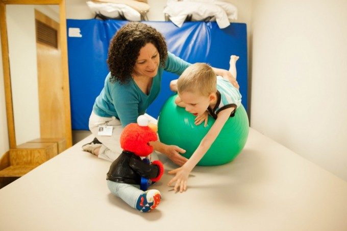 Young boy working with Physical Therapist