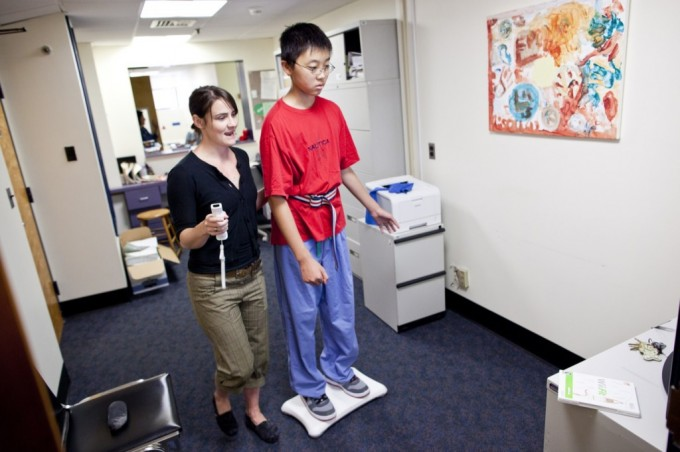 Young boy working with Physical Therapist as part of rehabilitation