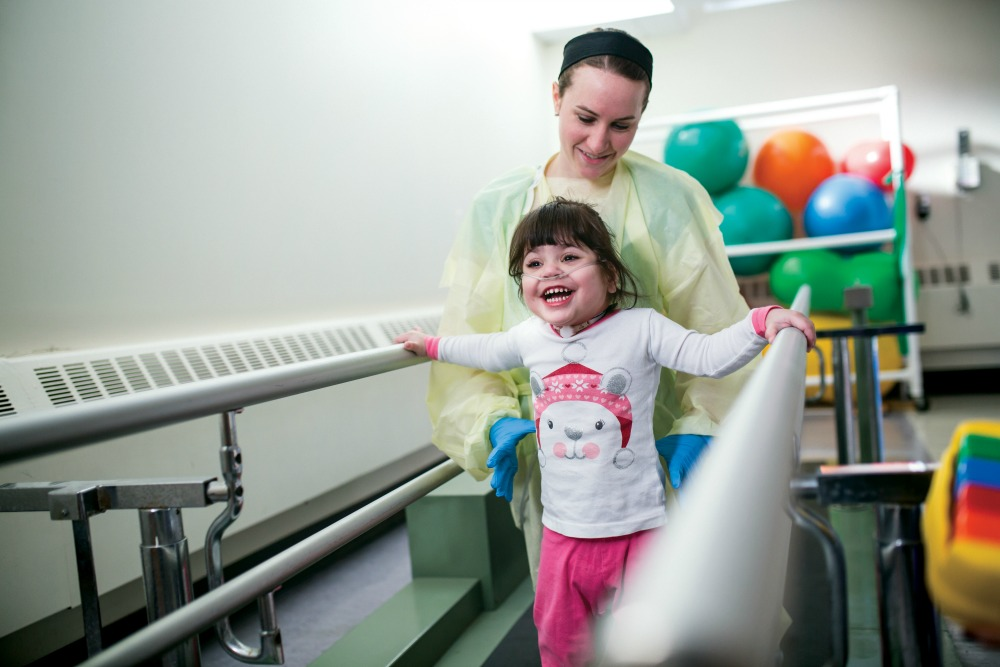 Young girl working with Physical Therapist as part of rehabilitation