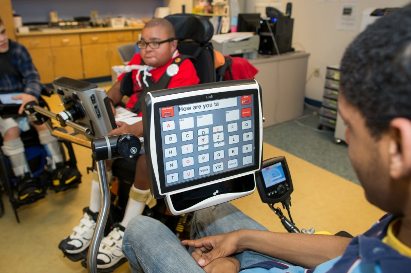 Student Using Assistive Technology Device