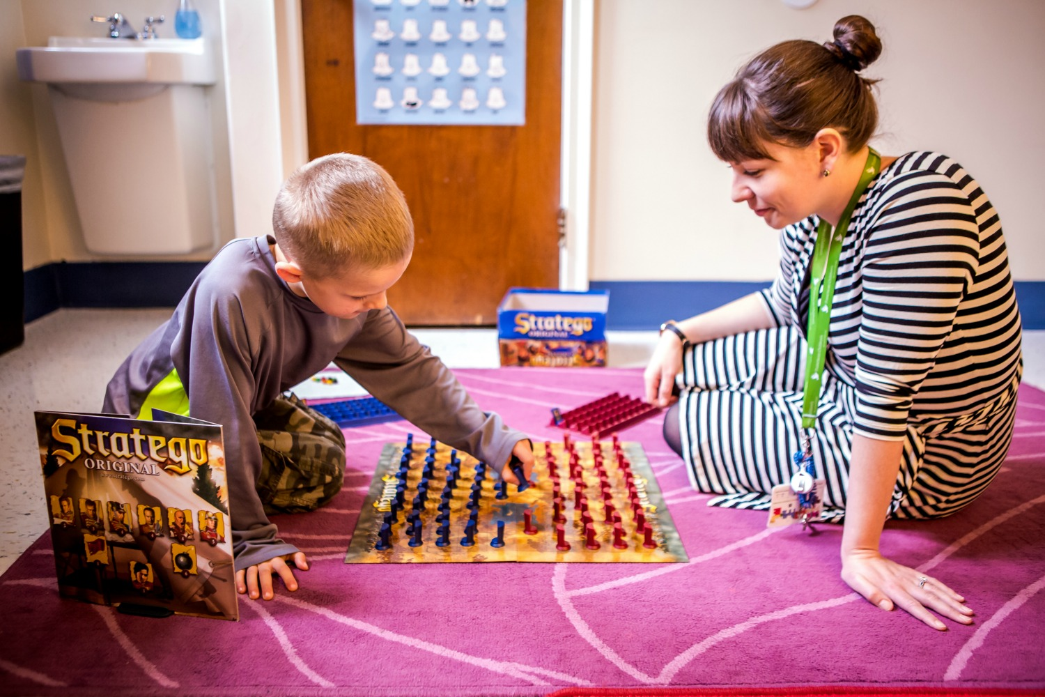 "Dr. Kiera Boyle and a patient play a game of ""Stratego"" during a therapy session."