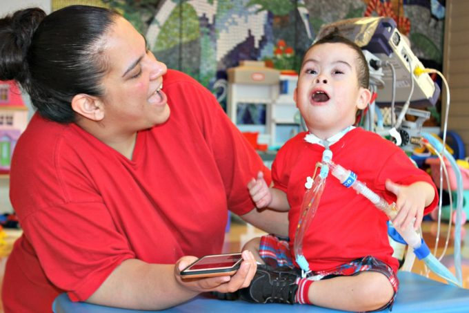 Kayden, a patient in the Inpatient Pulmonary Rehabilitation program at Franciscan Children's sings a song with his mom in the playroom